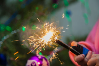 child with sparkler and lighter
